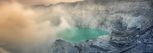 Smoking Ijen crater lake in East Java, Indonesia