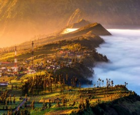 Cemara Lawang village on the edge of the ancient crater in which active volcano Bromo resides