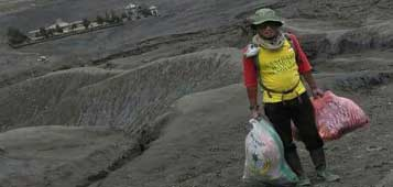 Tris is collecting waste at the Sea of Sand that surrounds Mt. Bromo